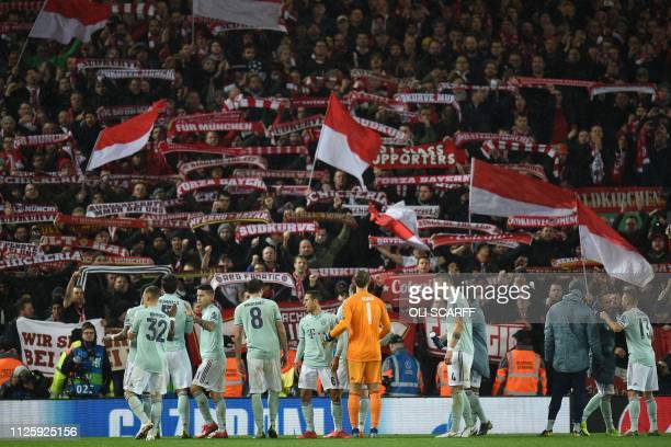 Bayern players go over to their fans after the UEFA Champions League round of 16 first leg football match between Liverpool and Bayern Munich at...