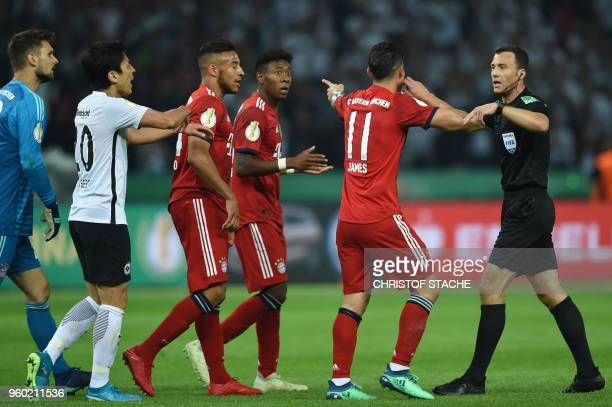 Bayern players look for a penalty from Referee Felix Zwayer during the German Cup DFB Pokal final football match FC Bayern Munich vs Eintracht...