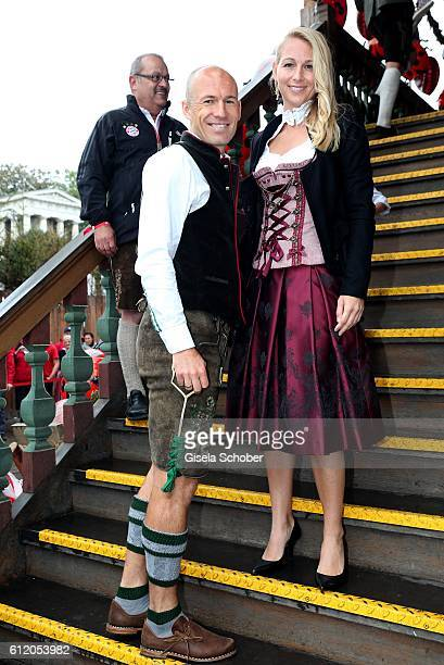 Bayern Soccer player Arjen Robben and his wife Bernadien Robben attend the 'FC Bayern Wies'n' during the Oktoberfest at Kaeferschaenke /...