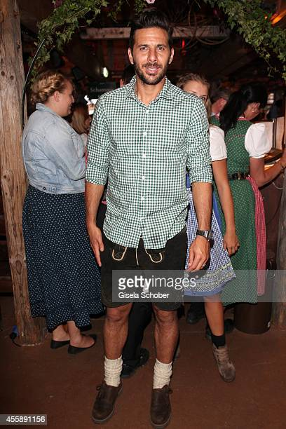 Bayern soccer player Claudio Pizarro during Wiesn Oktoberfest at Theresienwiese on September 21 2014 in Munich Germany