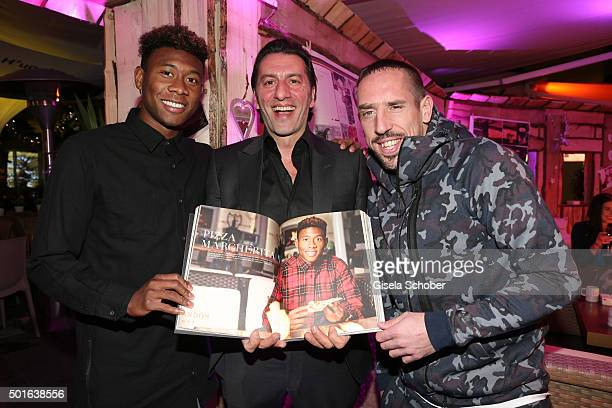 Bayern soccer player David Alaba host Ugo Crocamo and Franck Ribery during the launch event of H'ugo's first pizza cooking book at H'ugo's on...