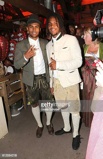 Bayern Soccer player Douglas Costa and Renato Sanches attend the 'FC Bayern Wies'n' during the Oktoberfest at Kaeferschaenke / Theresienwiese on...