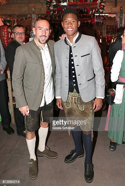 Bayern Soccer player Franck Ribery and David Alaba wearing 'Amsel Fashion' attend the 'FC Bayern Wies'n' during the Oktoberfest at Kaeferschaenke /...