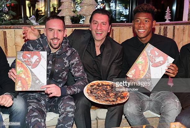 Bayern soccer player Franck Ribery host Ugo Crocamo and David Alaba during the launch event of H'ugo's first pizza cooking book at H'ugo's on...