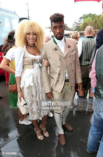 Bayern Soccer player Kingsley Coman and his wife Sephora Coman attend the 'FC Bayern Wies'n' during the Oktoberfest at Kaeferschaenke /...