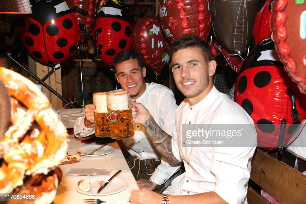 Bayern soccer player Philippe Coutinho and Lucas Hernandez during the Oktoberfest 2019 at Theresienwiese on September 24, 2019 in Munich, Germany.
