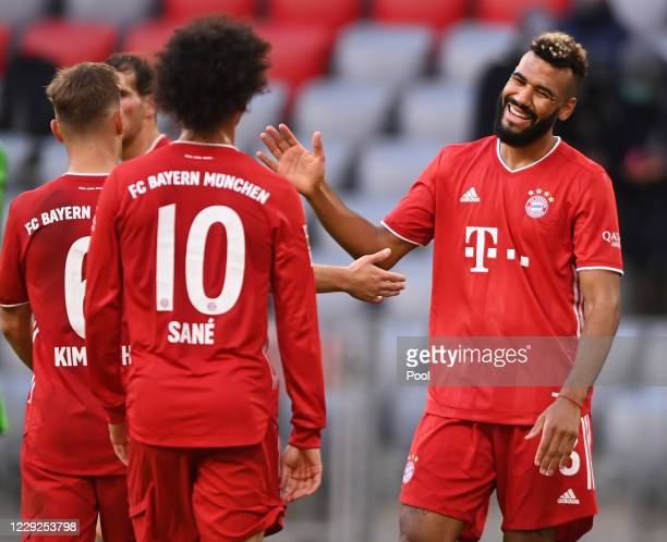 Bayern's Eric Maxim ChoupoMoting celebrates his sides fifth goal scored by Jamal Musiala during the Bundesliga match between FC Bayern Muenchen and...