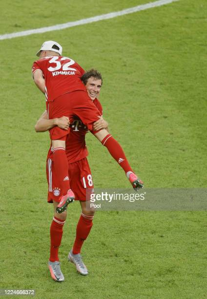 Bayern's Joshua Kimmich and Bayern's Leon Goretzka celebrat after their teams victory during the DFB Cup final match between Bayer 04 Leverkusen and...
