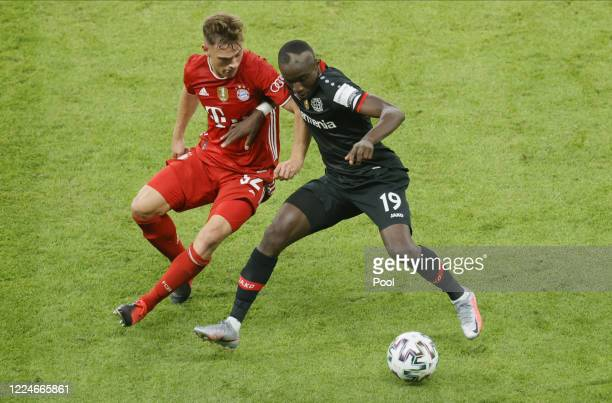 Bayern's Joshua Kimmich and Leverkusen's Moussa Diaby in action during the DFB Cup final match between Bayer 04 Leverkusen and FC Bayern Muenchen at...