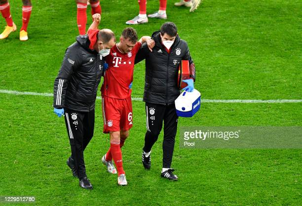 Bayern's Joshua Kimmich walks off after receiving medical treatment during the Bundesliga match between Borussia Dortmund and FC Bayern Muenchen at...