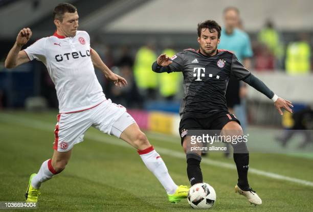 Bayern's Juan Bernat and Duesseldorf's Oliver Fink vie for the ball during the Telekom Cup soccer match between Fortuna Duesseldorf and Bayern Munich...