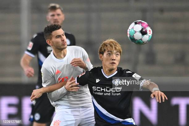 Bayern's Lucas Hernandez in action against Bielefeld's Ritsu Doan during the Bundesliga match between DSC Arminia Bielefeld and FC Bayern Muenchen at...