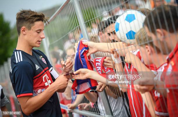 Bayern's Marco Friedl gives autographs after the soccer test match between FSV ErlangenBruck and FC Bayern Munich in Herzogenaurach Germany 9 July...