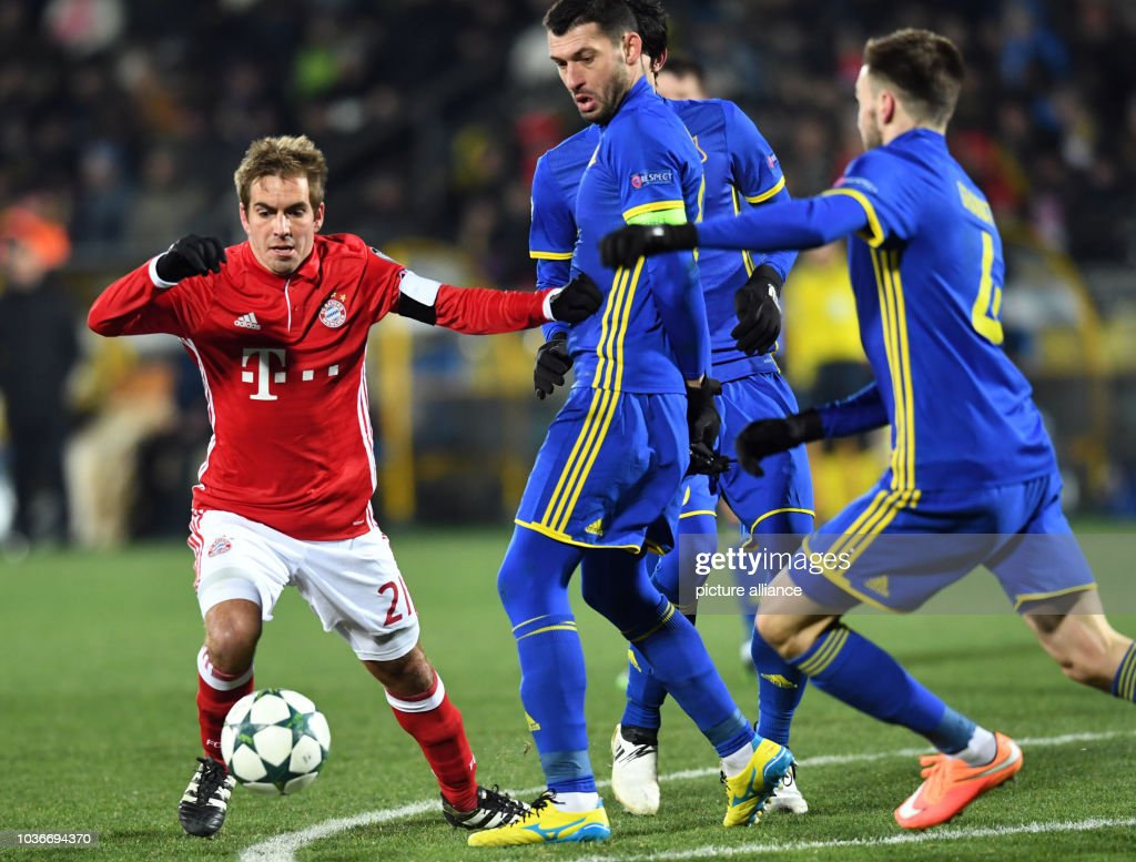 Bayern s Philipp Lahm (l) and FC Rostov players vie for the ball during the 80c9556fd