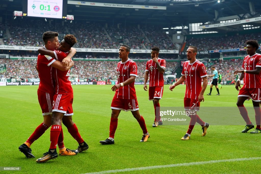 Bayern's players celebrate during the German First division Bundesliga football match between Werder Bremen and Bayern Munich in Bremen, northern Germany, on August 26, 2017. /