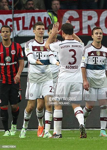 Bayern's players celebrate teammate Thomas Mueller scoring the 30 during the German first division Bundesliga football match Eintracht Frankfurt vs...