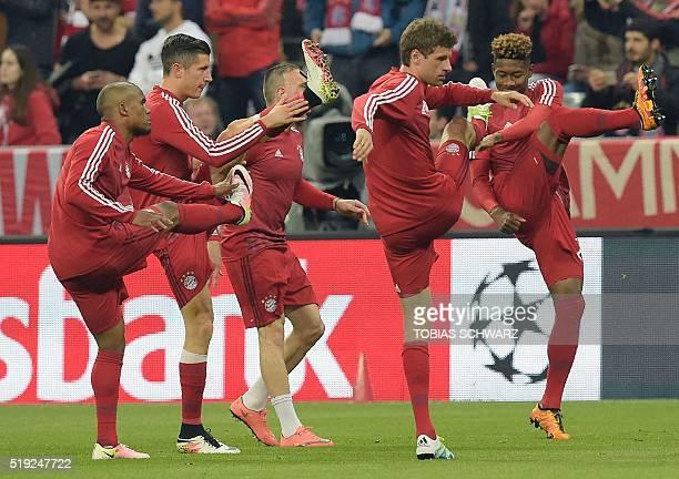 Bayern's players warm up prior to the Champions League quarterfinal firstleg football match between Bayern Munich and Benfica Lisbon in Munich...