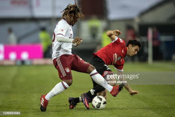 Bayern's Renato Junior Luz Sanches and Mainz's Gerrit Holtmann vie for the ball during the Telekom Cup final soccer match between Bayern Munich and...