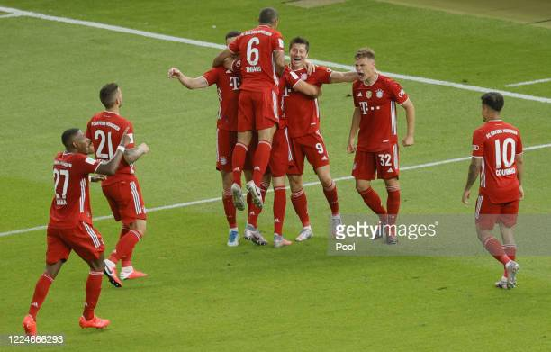 Bayern's Robert Lewandowski celebrates with teammates after scoring his team's fourth goal during the DFB Cup final match between Bayer 04 Leverkusen...