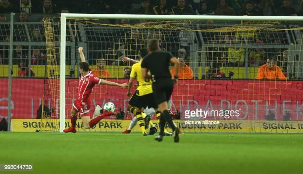 Bayern's Robert Lewandowski shoots the 03 goal during the German Bundesliga soccer match between Borussia Dortmund and Bayern Munich at the Signal...