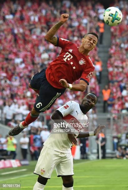 Bayern's Spanish midfielder Thiago Alcantara heads the ball next to Stuttgart's Orel Mangala during the German first division Bundesliga football...