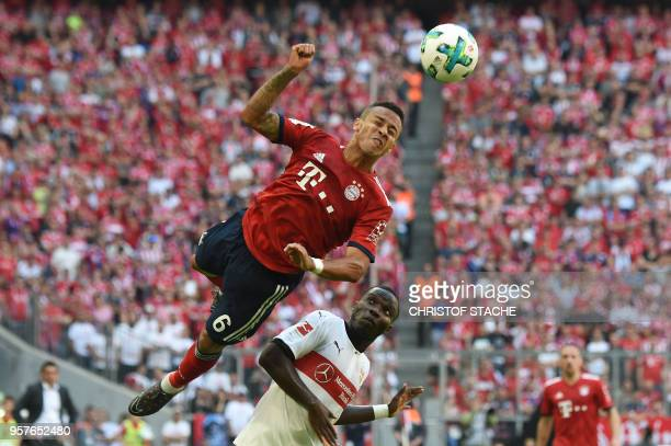 TOPSHOT Bayern's Spanish midfielder Thiago Alcantara heads the ball next to Stuttgart's Orel Mangala during the German first division Bundesliga...