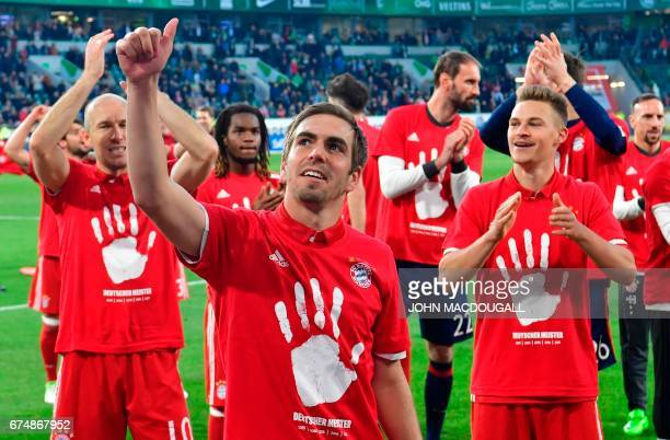 Bayern's team celebrates becoming the new German champion after the German first division Bundesliga football match between VfL Wolfsburg and Bayern...