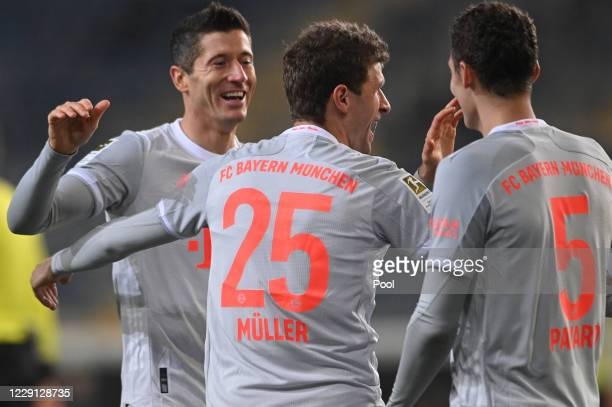 Bayern's Thomas Mueller celebrates his 04 goal with Bayern's Robert Lewandowski and Bayern's Benjamin Pavard during the German Bundesliga match...