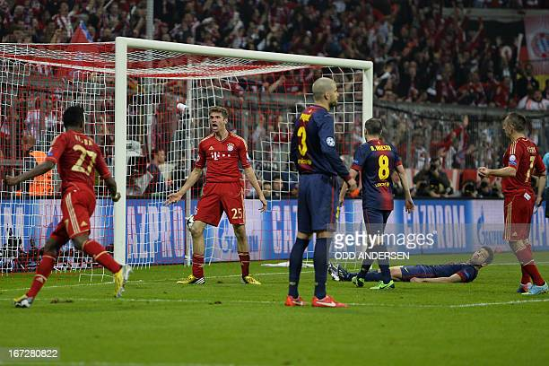 Bayern's Thomas Mueller reacts after scoring teh fourth goal during the UEFA Champions league first leg semi-final football match between Bayern...