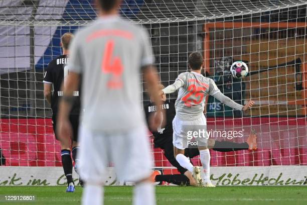 Bayern's Thomas Mueller scores the 01 goal during the Bundesliga match between DSC Arminia Bielefeld and FC Bayern Muenchen at Schueco Arena on...