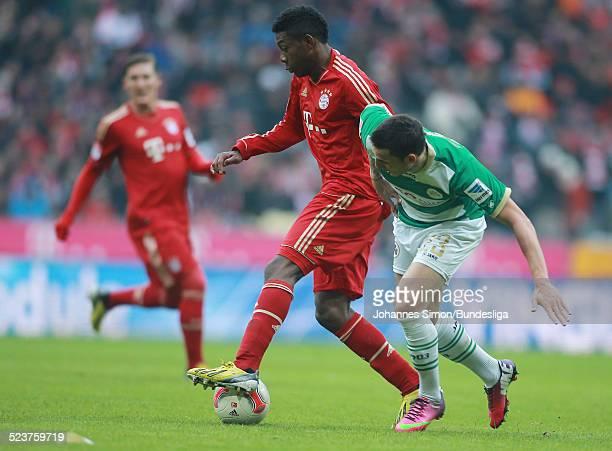 BayernSpieler David Alaba und der Fuerther Milorad Pekovic kaempfen um den Ball beim Bundesligaspiel FC Bayern Muenchen gegen die SpVgg Greuther...