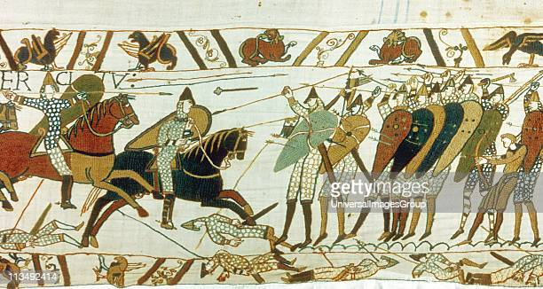 Bayeux Tapestry 1067 Battle of Hastings 14 October 1066 AngloSaxon foot soldiers defend themselves with wall of shields against Norman cavalry Men...