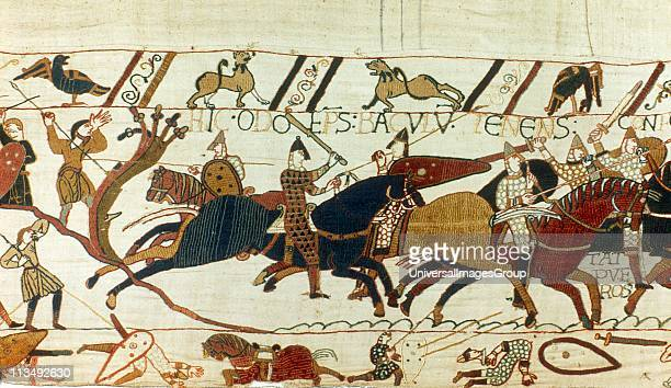 Bayeux Tapestry 1067 Battle of Hastings 14 October 1066 Norman cavalry with spears and swords attacking the English Riderless horse and casualties in...