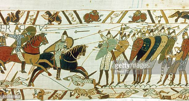 Bayeux Tapestry Battle of Hastings 14 October 1066 AngloSaxon foot soldiers defend themselves with wall of shields against Norman cavalry Men lie...