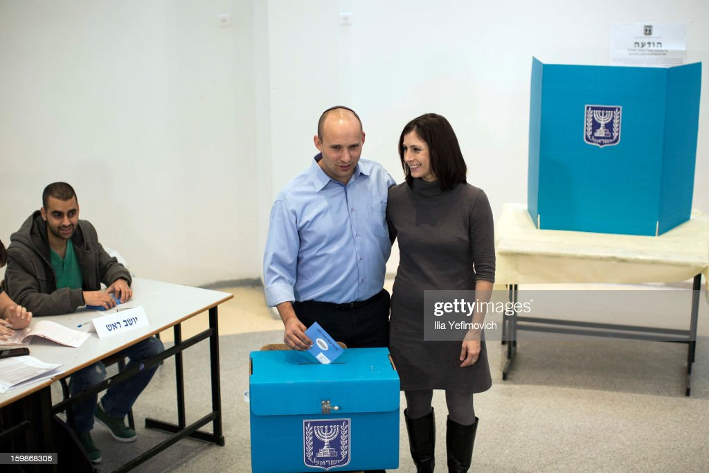 Bayit Yehudi (Jewish Home) party leader Naftali Bennett casts his vote in the Israeli General Election alongside his wife on January 22, 2013 in Ra'anana, Israel. The latest opinion polls suggest that current Prime Minister Benjamin Netanyahu will return to office, albeit with a reduced majority.