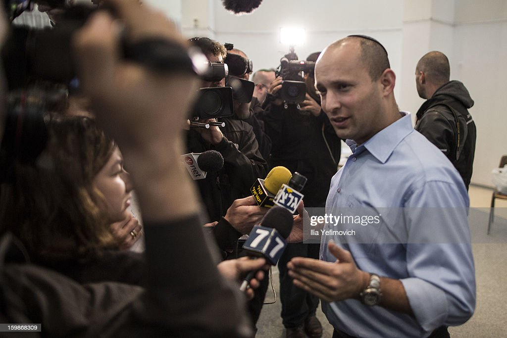 Bayit Yehudi (Jewish Home) party leader Naftali Bennett waves to supporters alongside his wife after casting his vote in the Israeli General Election on January 22, 2013 in Ra'anana, Israel. The latest opinion polls suggest that current Prime Minister Benjamin Netanyahu will return to office, albeit with a reduced majority.