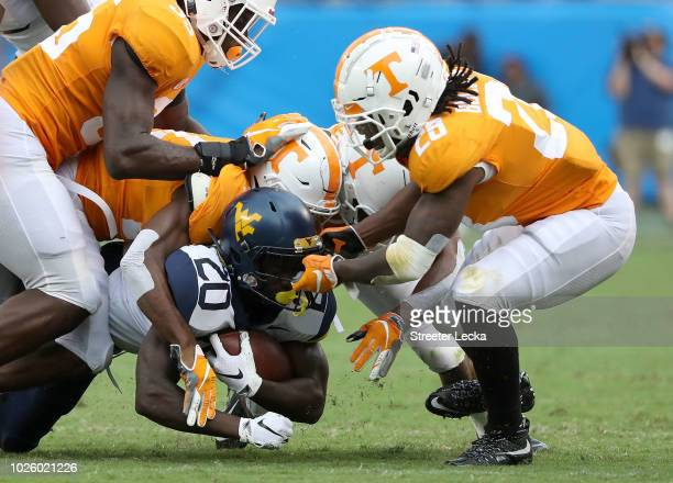 Baylen Buchanan of the Tennessee Volunteers tries to stop Alec Sinkfield of the West Virginia Mountaineers during their game at Bank of America...
