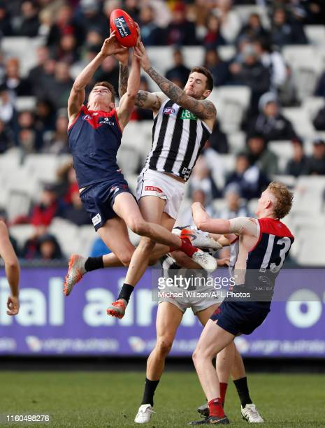 Bayley Fritsch of the Demons and Jeremy Howe of the Magpies compete for the ball during the 2019 AFL round 21 match between the Melbourne Demons and...