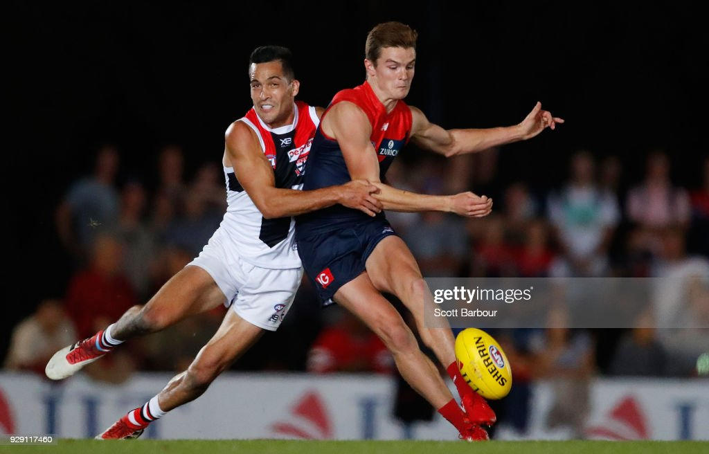 Bayley Fritsch of the Demons and Shane Savage of the Saints compete for the ball during the JLT Community Series AFL match between the Melbourne Demons and the St Kilda Saints at Casey Fields on March 8, 2018 in Melbourne, Australia.