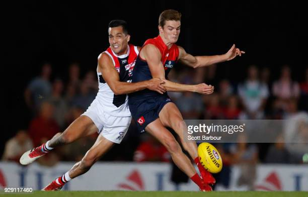 Bayley Fritsch of the Demons and Shane Savage of the Saints compete for the ball during the JLT Community Series AFL match between the Melbourne...