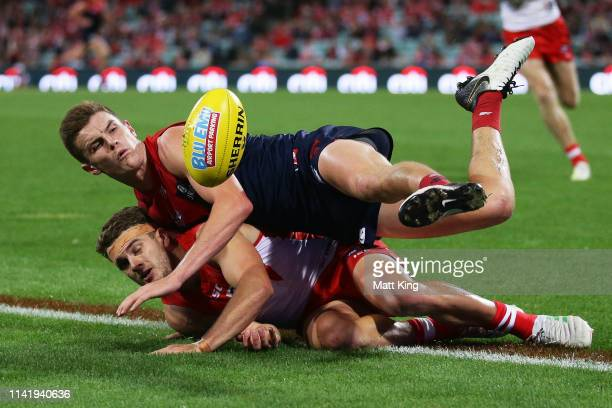 Bayley Fritsch of the Demons competes for the ball against Tom Papley of the Swans during the round four AFL match between the Sydney Swans and the...