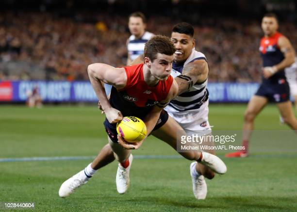Bayley Fritsch of the Demons is tackled by Tim Kelly of the Cats during the 2018 AFL First Elimination Final match between the Melbourne Demons and...