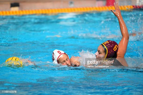 Bayley Weber of the USC Trojans and Kat Klass of the Stanford Cardinal battle for the ball during the Division I Women's Water Polo Championship held...