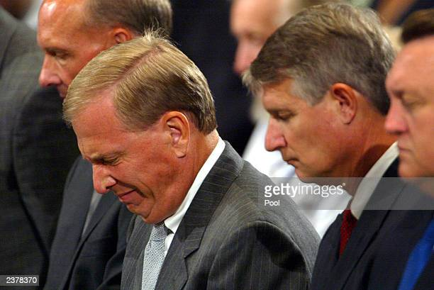 Baylor basketball coach Dave Bliss bows his head in prayer and silence during memorial services for Patrick James Dennehy August 7 2003 at the...