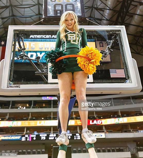 Baylor Bears cheerleader poses through the rim after the NCAA Big 12 Women's basketball championship game between the Baylor Bears and the Texas...