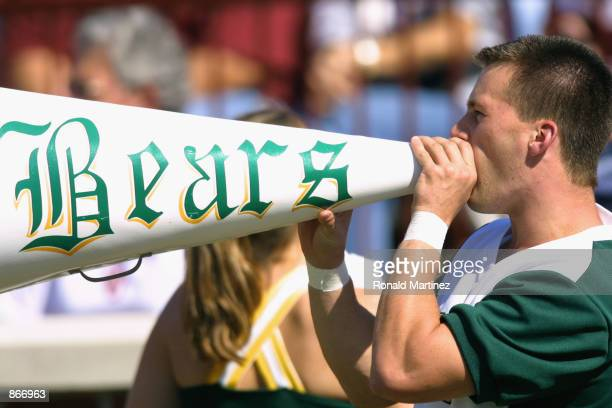Baylor Bears cheerleader yells through a megaphone before the Big 12 Conference football game against the Oklahoma Sooners on October 20 2001 at...
