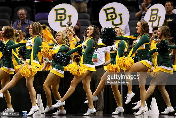 Baylor Bears cheerleaders perform during the third round of the 2014 NCAA Men's Basketball Tournament against the Creighton Bluejays at the ATT...