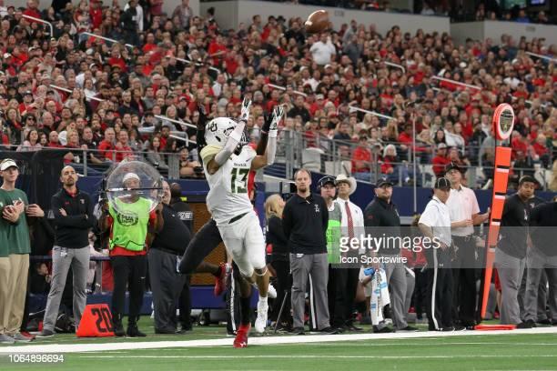 Baylor Bears cornerback Raleigh Texada leaps to make an interception during the TFBI Shootout between the Baylor Bears and Texas Tech Red Raiders on...