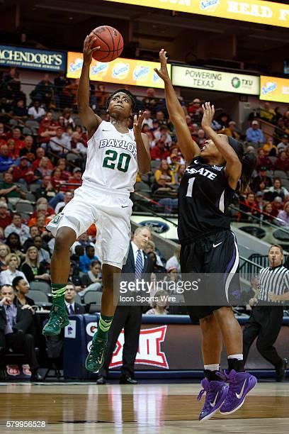 Baylor Bears forward Nina Davis hits a layup with Kansas State Wildcats guard Haley Texada defending during the NCAA Big 12 Women's basketball...
