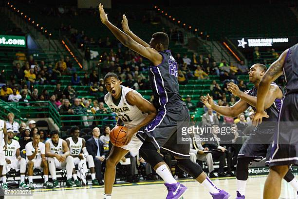 Baylor Bears forward TJ Maston is defended by TCU Horned Frogs center Link Kabadyundi during the NCAA basketball game between the TCU Horned Frogs...